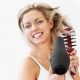woman-with-hair-dryer-and-brush
